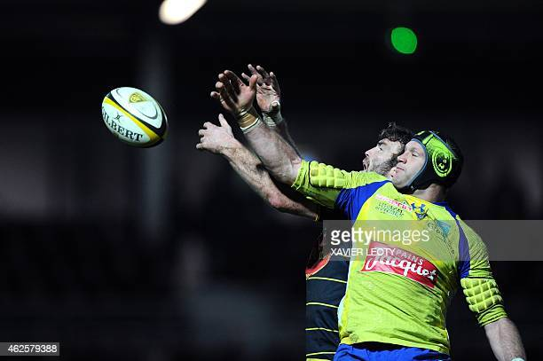 La Rochelle's French Kevin Gourdon vies for the ball with Clermont's Alexandre Lapandry during the French Top 14 rugby union match La Rochelle vs...