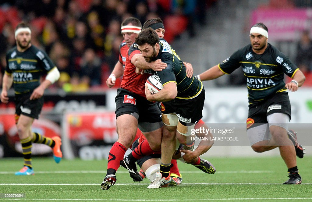 La Rochelle's French number eighnt Kevin Gourdon (2nd R) is tackled by Oyonnax's Czech prop Lukas Rapant (L) during the French Top 14 Rugby Union match between Union Sportive Oyonnax Rugby (USO) and Atlantique Stade Rochelais (ASR) on April 30, 2016 at the Charles-Mathon stadium in Oyonnax, central eastern France. / AFP / ROMAIN