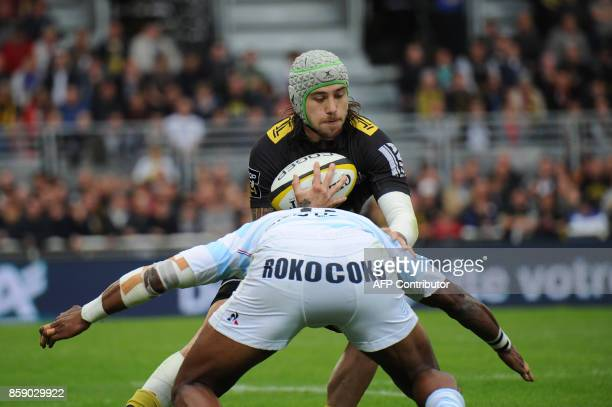 TOPSHOT La Rochelle's French wing Gabriel Lacroix is tackled by Racing 92 New Zealander wing Joe Rokocoko during the French Top 14 rugby union match...