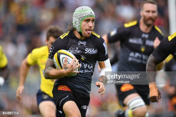 La Rochelle's French wing Gabriel Lacroix runs with the ball during the French Top 14 rugby union match between La Rochelle and Clermont on September...