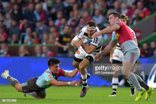 La Rochelle's French wing Jeremy Sinzelle is tackled during the European Rugby Champions Cup rugby union round 1 pool match between Harlequins and La...