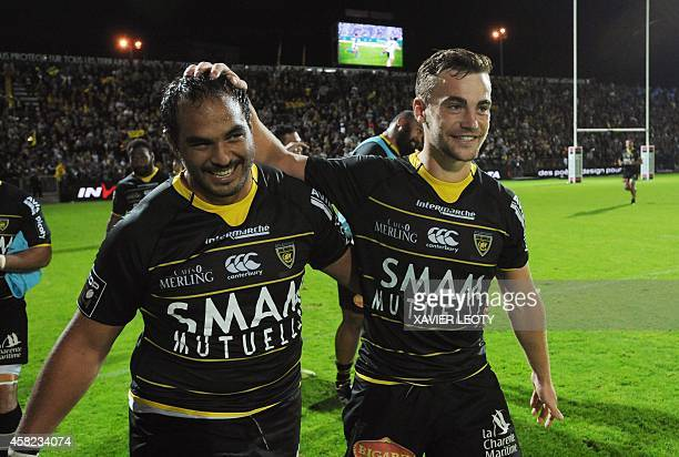 La Rochelle's Hikairo Forbes and Charles Bouldoire celebrate at the end of the French Top 14 rugby union match between La Rochelle and Montpellier at...
