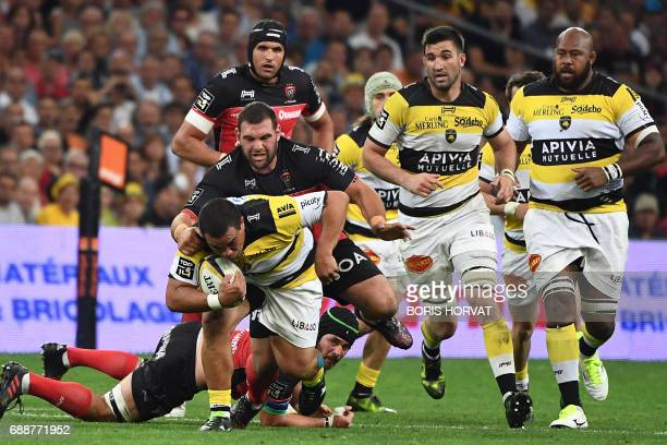 La Rochelle's player Hikairo Forbes vies with RC Toulon's South African lock Juandre Kruger during the French Top 14 rugby union match between RC...