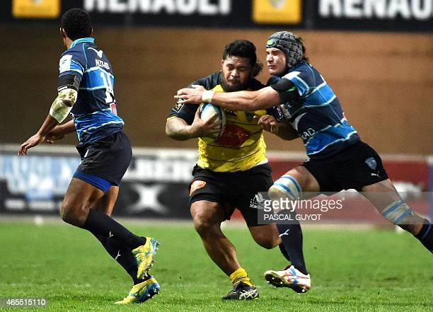 La Rochelle's Vincent Pelo vies with Montpellier's centre Lucas Dupont and Montpellier's Ben Mowen during the French Top 14 rugby union match between...