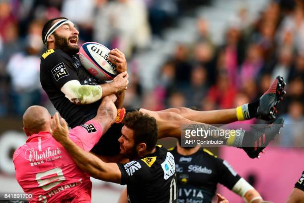 La Rochelle's wing Jeremy Sinzelle vies with Stade Francais Italian flanker Sergio Parisse during the French Top 14 rugby union match between Stade...