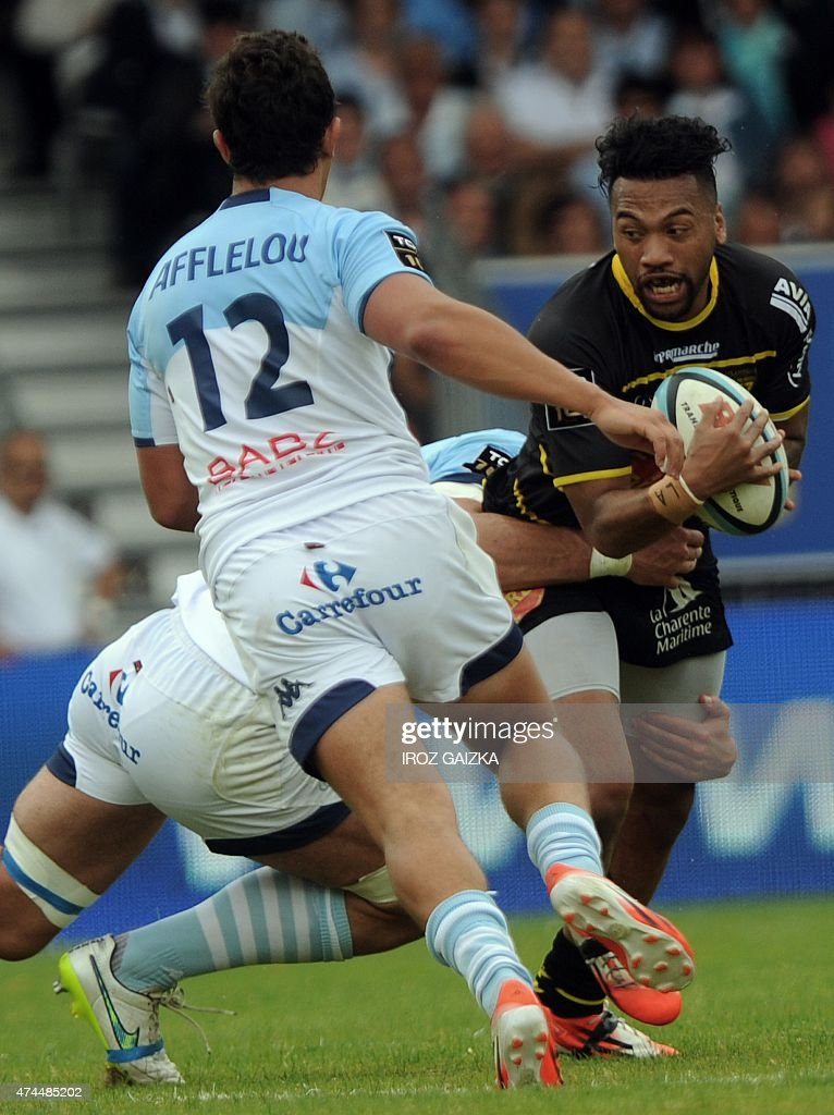 La Rochelle's winger Alofa Alofa is tackled by Bayonne's french Jean Monribot during the French Top14 rugby union match between Aviron Bayonnais and...