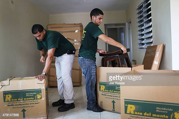 La Rosa del Monte movers pack up Yessenia Puente's apartment as she prepares to move to Orlando Florida this weekend on July 1 2015 in San Juan...