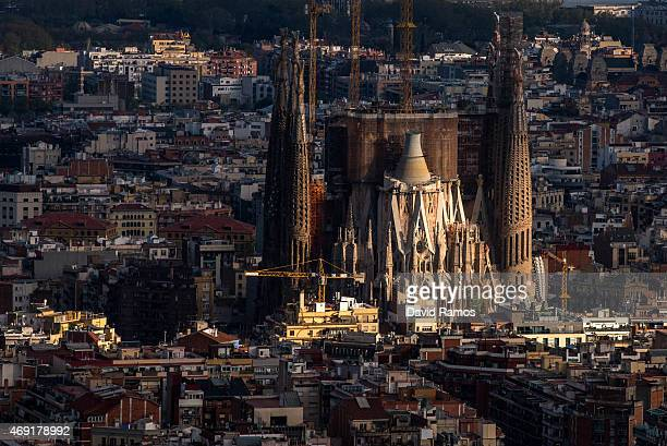 'La Sagrada Familia' stands over residential buildings on April 10 2015 in Barcelona Spain Barcelona's city hall has put a regulation in motion that...