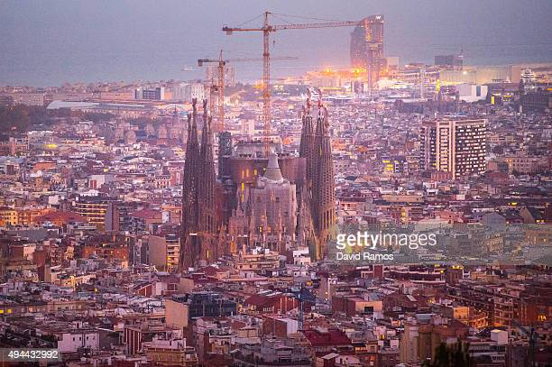 'La Sagrada Familia' stands over residential buildings on October 26 2015 in Barcelona Spain 'La Sagrada Familia' Foundation announced on October 21...