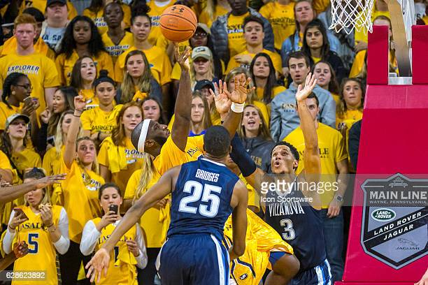 La Salle Explorers guard Jordan Price fires his shot as he falls backwards during the game between the LaSalle Explorers and the Villanova Wildcats...