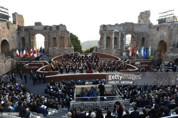 La Scala Philharmonic Orchestra performs in the ancient Greek Theatre of Taormina during the Heads of State and of Government G7 summit on May 26...