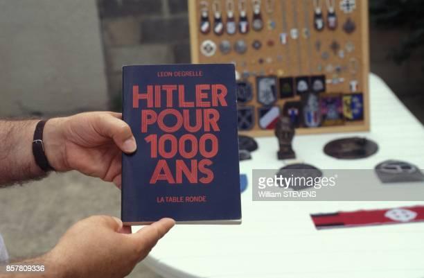 La Societe de Claude Cornilleau diffuse des insignes nazis interdis de vente ici un livre sur Hitler le 13 juillet 1994 a Paris France