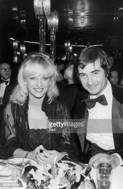 La speakerine Evelyne Leclercq et JeanClaude Brialy au dîneranniversaire du Paradis latin le 28 janvier 1980 à Paris France