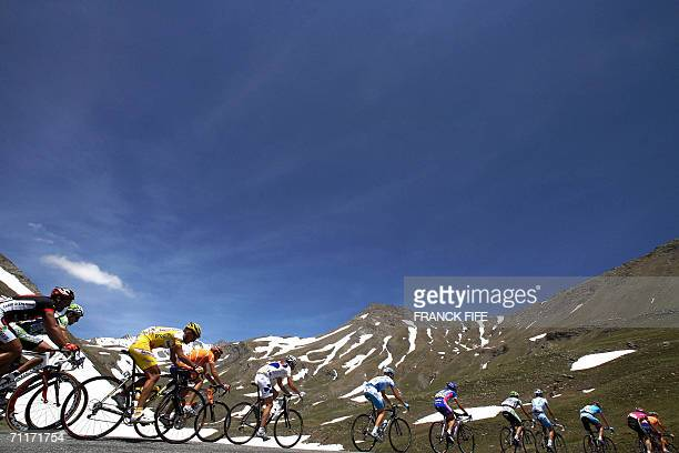 Cyclists ride during the 6th stage between Briancon and La Toussuire of the 58th Dauphine Libere cycling race 10 June 2006 in La Toussuire French...
