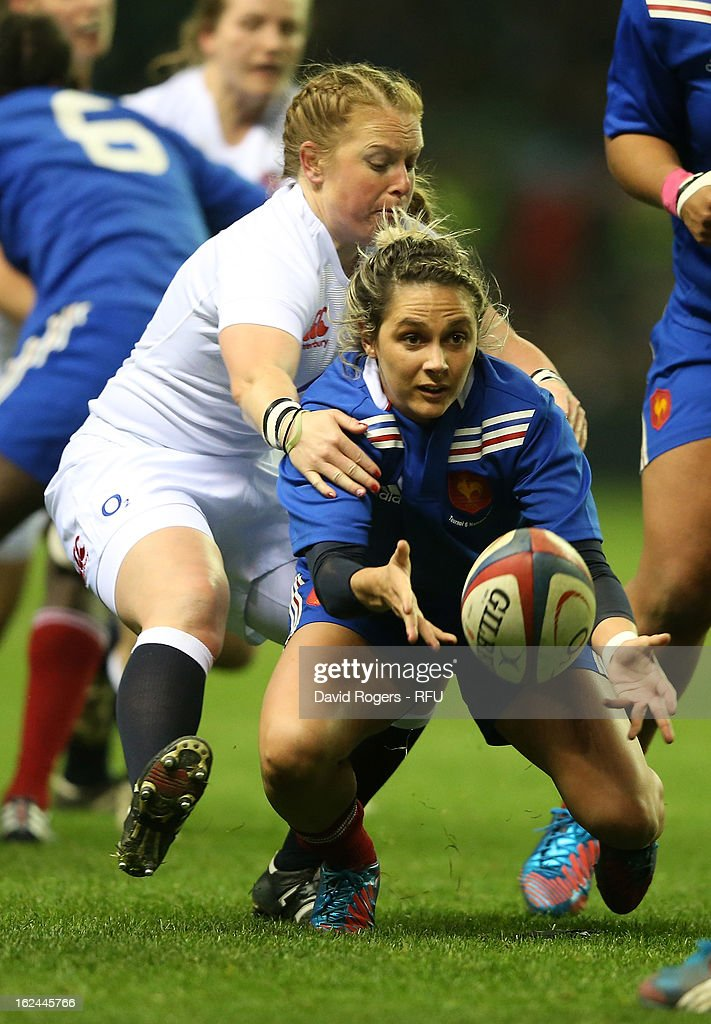 La Toya Mason of England tackles Marie Alice Yahe of France during the Women's RBS Six Nations match between England and France at Twickenham Stadium on February 23, 2013 in London, England.
