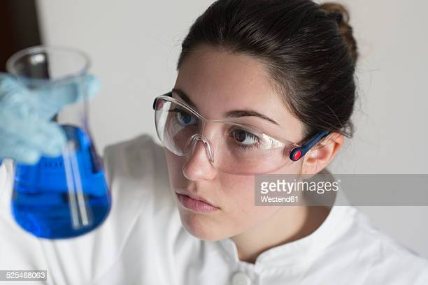 Lab technician examining liquid