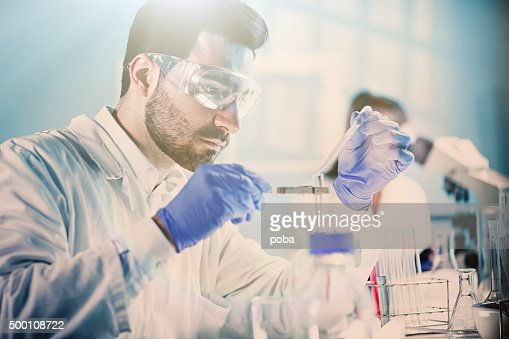 Lab Technician Holding Test Tube