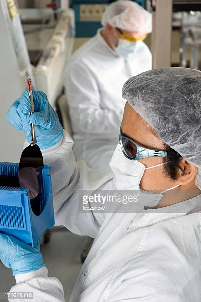 Lab Technician Inspecting a Silicon Wafer - Series