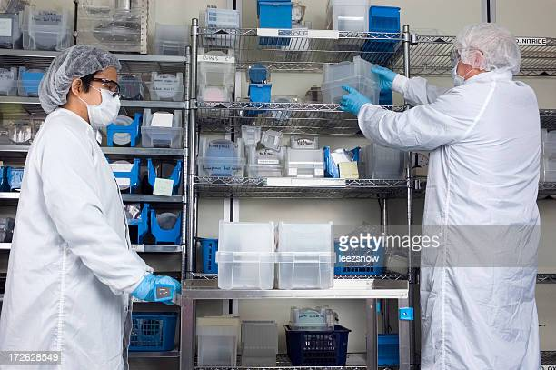 Lab Technician Pushing a Cart in Lab
