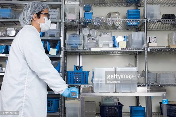 Lab Technician Pushing a Cart