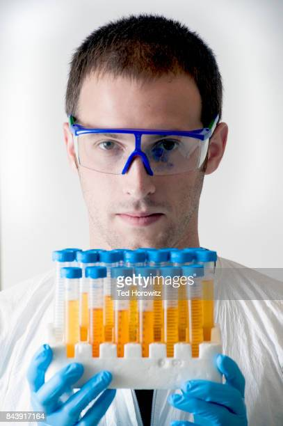 Lab technician with test tubes
