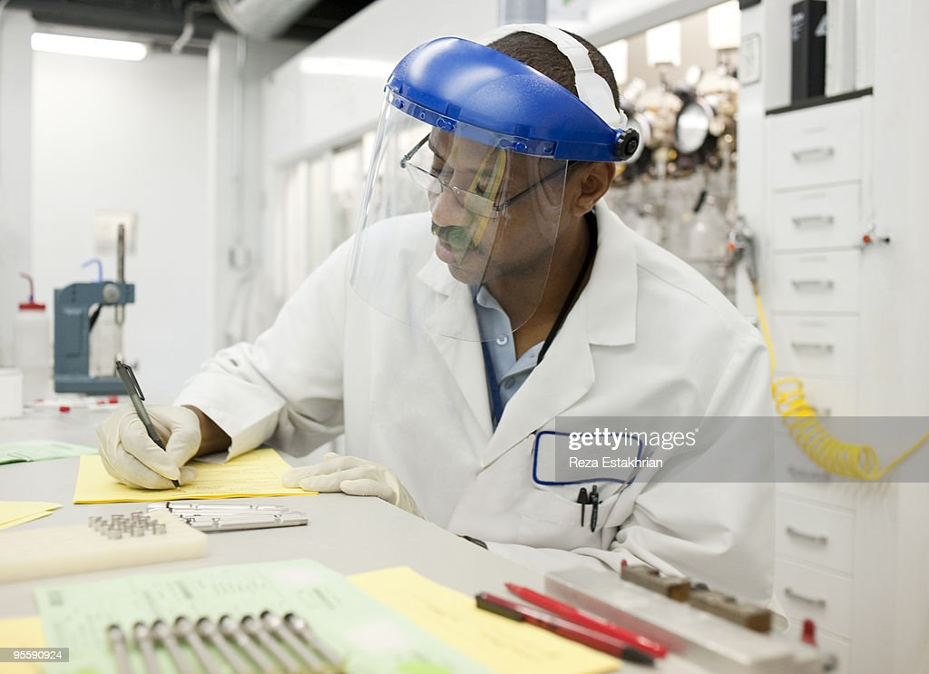 Lab worker prepares a report : Stock Photo
