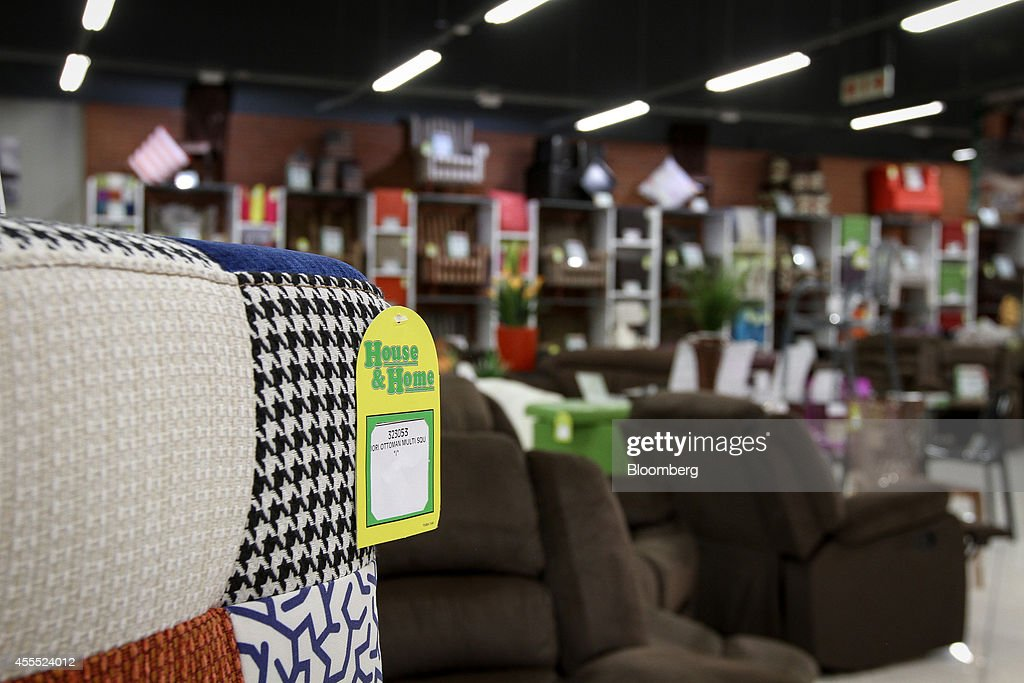 A label hangs from a chair for sale inside a House   Home furniture store. Retail At Shoprite Holding Ltd  s OK Furniture And House   Home