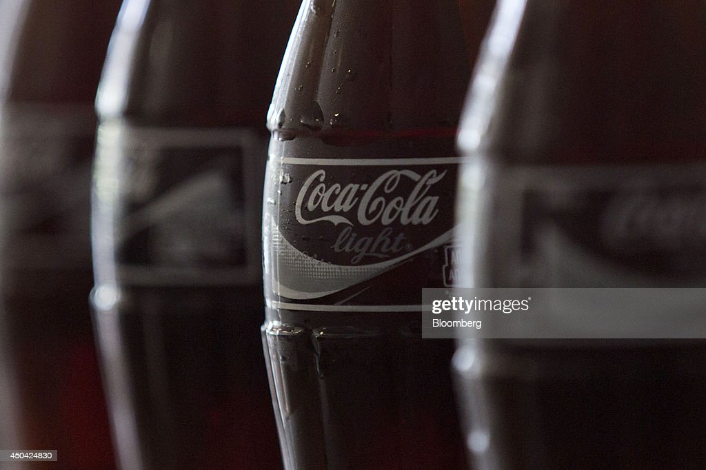 A label sits on a bottle of Coca-Cola Light, also known as diet Coke, as it travels along the production line at the Lanitis Bros Ltd. bottling plant, part of the Coca-Cola Hellenic Group, in Nicosia, Cyprus, on Tuesday, June 10, 2014. Zug, Switzerland-based Coca-Cola Hellenic Bottling Co., which distributes Coca-Cola products in countries including Russia, wants to move away from using imported sugar for its Russian operations by 2015. Photographer: Andrew Caballero-Reynolds/Bloomberg via Getty Images