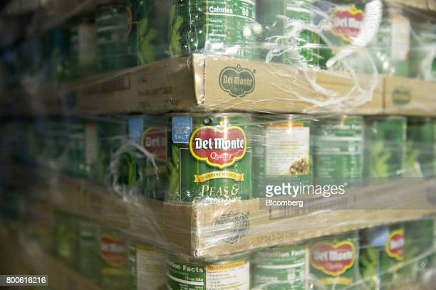 Labeled cans of peas and carrots sit on a pallet for delivery at the Del Monte Foods Inc facility in Mendota Illinois US on Friday June 23 2017 The...