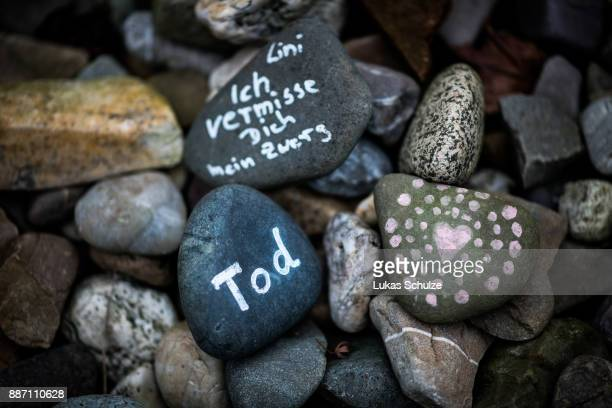 Labeled stones lie at the memorial of the 2010 Love Parade disaster on December 6 2017 in Duisburg Germany On December 8 six city officials and four...