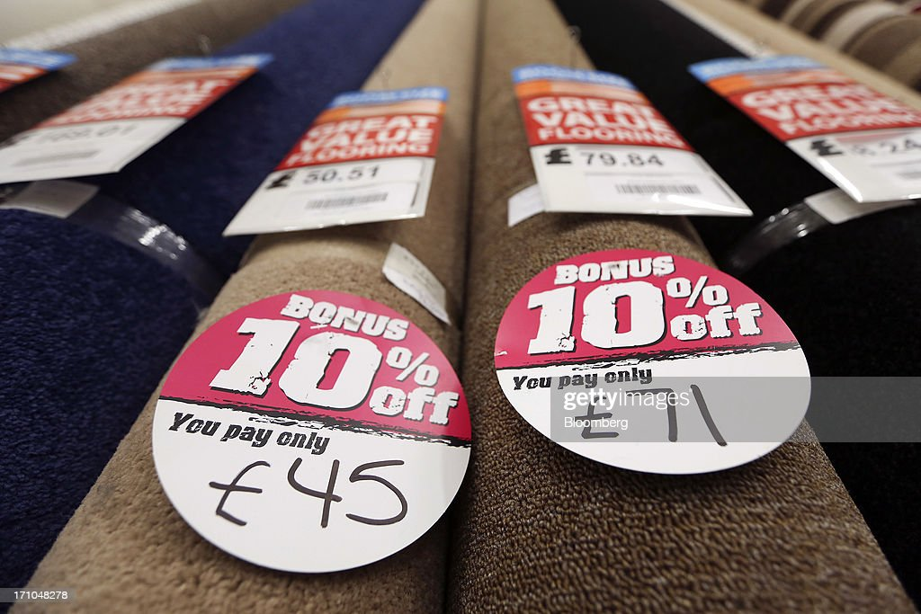 Labels advertising discount prices sit on rolls of pre-cut carpet displayed for sale inside a Carpetright Plc store in Basildon, U.K., on Friday, June 21, 2013. U.K. retail sales rose more than economists forecast in May as consumers spent more online and food sales increased at their fastest pace for more than two years. Photographer: Chris Ratcliffe/Bloomberg via Getty Images