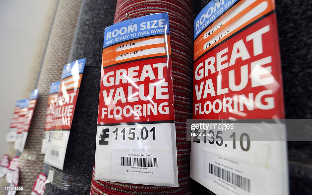 Labels advertising prices sit on pre-cut rolls of carpet displayed for sale inside a Carpetright Plc store in Basildon, U.K., on Friday, June 21, 2013. U.K. retail sales rose more than economists forecast in May as consumers spent more online and food sales increased at their fastest pace for more than two years. Photographer: Chris Ratcliffe/Bloomberg via Getty Images