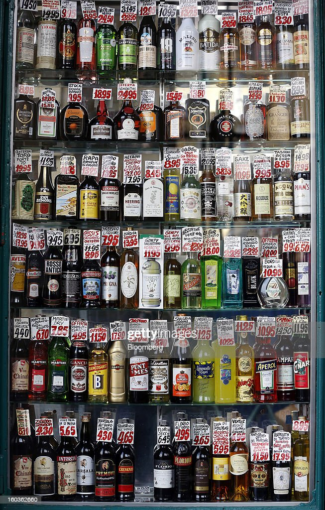 Labels display the price in euros of alcoholic beverages displayed in the window of a store in Turin, Italy, on Tuesday, Jan. 29, 2013. Italy sold 8.5 billion euros ($11.4 billion) of six-month Treasury bills as rates dropped to the lowest in almost three years as the European Central Bank's pledge to buy bonds continues to provide an effective backstop even amid rising political concerns. Photographer: Alessia Pierdomenico/Bloomberg via Getty Images