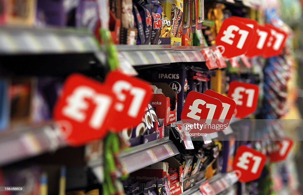Labels display the price in pounds of confectionary goods inside a Morrisons supermarket, operated by William Morrisons Supermarkets Plc, in Chadderton, U.K., on Monday, Dec. 17, 2012. The British Christmas is the biggest epicurean occasion of the year, with households spending a total of 4 billion pounds on food in the final week before Dec. 25. Photographer: Paul Thomas/Bloomberg via Getty Images
