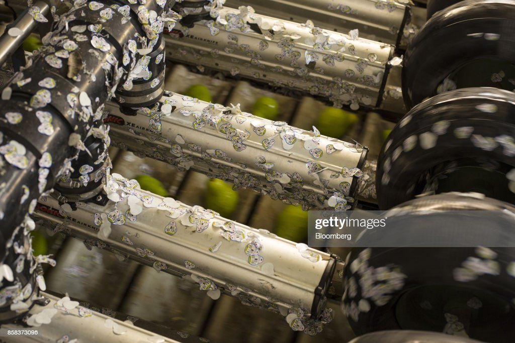 Labels for pears cover a machine at the Stemilt Growers packing facility in Wenatchee, Washington, U.S., on Wednesday, Sept. 20, 2017. Smoke from wildfires in the Cascade Mountains troubled pear pickers in the Wenatchee Valley and Northcentral Washington in mid September. However it benefits the fruit by cooling down temperatures and tends to delay maturity. Photographer: David Ryder/Bloomberg via Getty Images