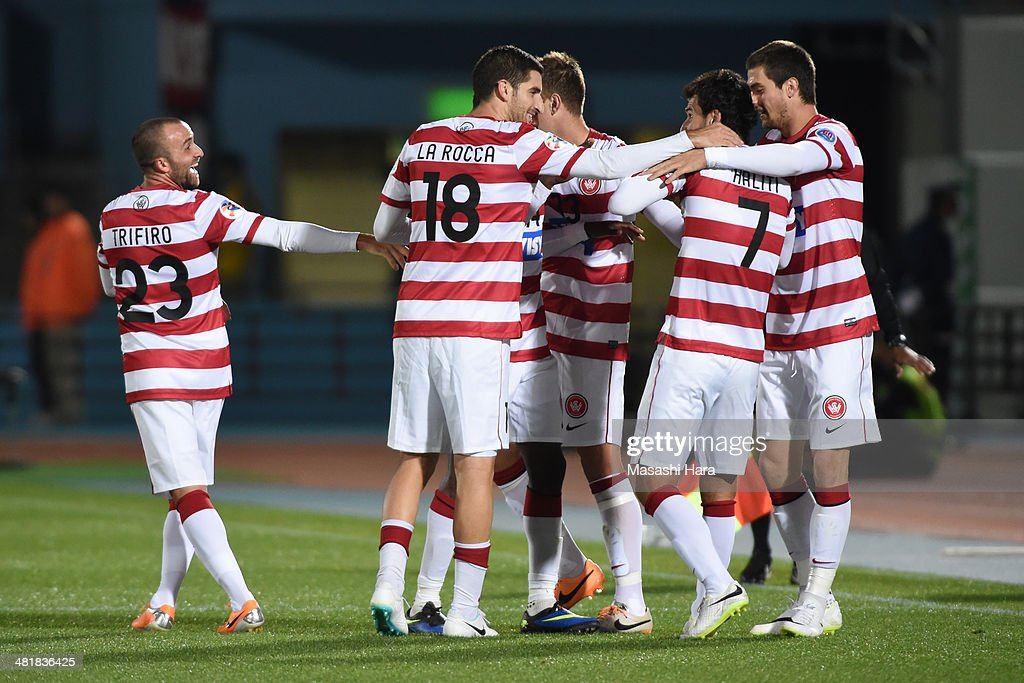 Labinot Haliti #7 (2nd R) of Western Sydney Wanderers celebrates with his team-mates after scoring the opening goal during the AFC Champions League Group H match between Kawasaki Frontale and Western Sydney Wanderers at Todoroki Stadium on April 1, 2014 in Kawasaki, Japan.