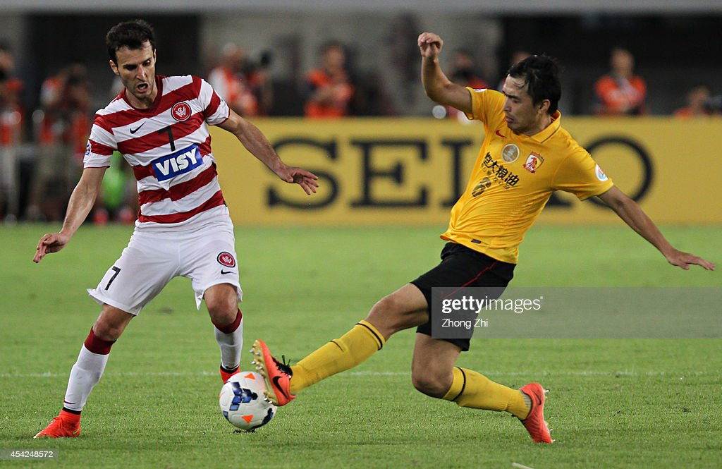 <a gi-track='captionPersonalityLinkClicked' href=/galleries/search?phrase=Labinot+Haliti&family=editorial&specificpeople=854400 ng-click='$event.stopPropagation()'>Labinot Haliti</a> of Western Sydney Wanderers in action with Feng Xiaoting of Guangzhou Evergrande during the Asian Champions League Quarter Final match between the Western Sydney Wanderers and Guangzhou Evergrande at Tianhe Sports Center on August 27, 2014 in Guangzhou, China.