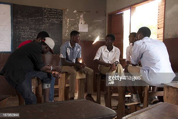Labone Senior High School students chat in a classroom on December 1 2012 in Accra Ghana's main opposition presidential candidate Nana AkufoAddo of...