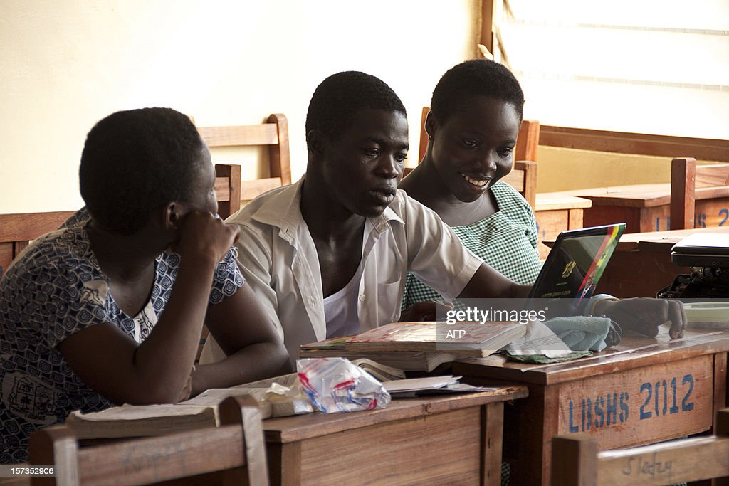 Labone Senior High School students Ernestina Quaye (L), Narteh Andrews (C) and Lisa Okudzetp (R) sit in a classroom on December 1, 2012 in Accra. Ghana's main opposition presidential candidate, Nana Akufo-Addo of the New Patriotic Party, is offering parents ahead of the December 7 elections a deal that seems difficult to refuse: abolishing fees at senior high schools, which can amount to several hundred dollars per term, and keep education out of reach for many families. The ruling party and incumbent President John Dramani Mahama says the idea is great on paper, but not yet possible as the money shortage could greatly harm education in this nation of 20 million people. The voters will have their say, but the fact that a true policy debate has occurred seems to be another sign of Ghana's maturing democracy.