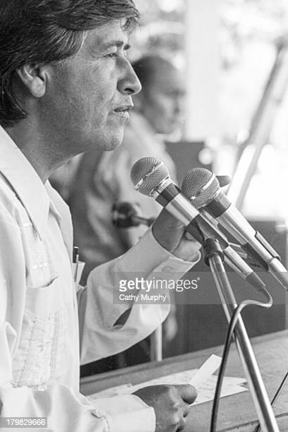 Labor activist and United Farm Workers cofounder Cesar Chavez speaks into a microphone Coachella California 1977