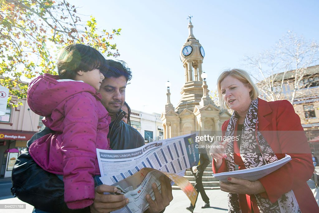 Labor candidate, Julie Owens MP talks through voting procedures with a local resident waiting in line at the Town Hall on July 2, 2016 in Parramatta, Australia. Voters head to the polls today to elect the 45th parliament of Australia.