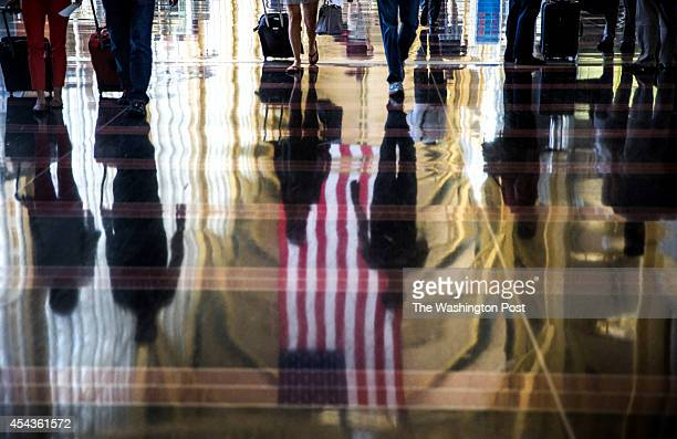 Labor day travelers are seen in a reflection on the concourse in Reagan National Airport August 29 ahead of the Labor Day holiday The cost of air...