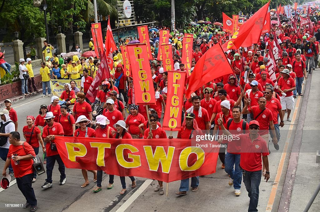 Labor groups and trade unions march near the presidential palace on May 1, 2013 in Manila, Philippines. The Philippines workers unions gather in the streets of Manila to demand, among other things, better pay, an end to contractualization and lower prices of basic commodities. Labor day is celebrated across South East Asia on May 1st and is seen as an opportunity to acknowledge the social and economic accomplishments of the workers.