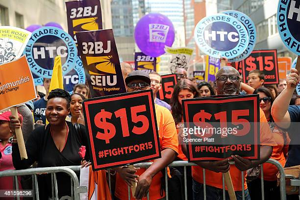 Labor leaders workers and activists attend a rally for a $15 minimum hourly wage on July 22 2015 in New York City A panel appointed by Governor...