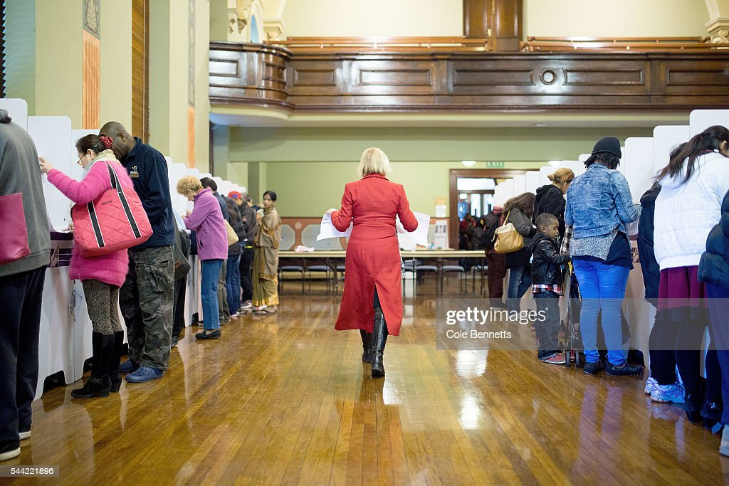 Labor MP, Julie Owens walks down the rows of voting booths to cast her vote at the Town Hall on July 2, 2016 in Parramatta, Australia. Voters head to the polls today to elect the 45th parliament of Australia.