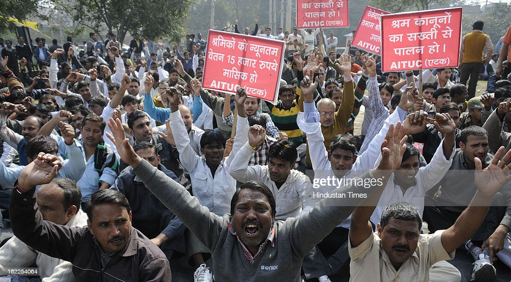 Labor organizations protest during two day-nation-wide strike called by Trade unions at Mahavir chowk on February 21, 2013 in Gurgaon, India.