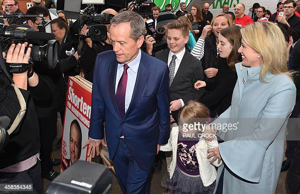 Labor Party leader Bill Shorten arrives to cast his vote with daughter Clementine and wife Chloe in Melbourne on July 2 2016 Australians flocked to...