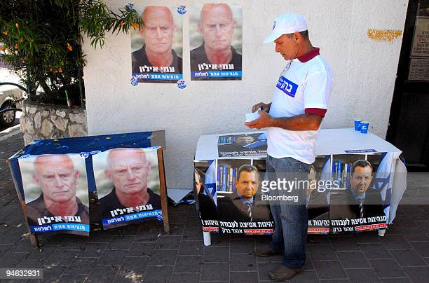 Labor party worker in Givataim is surrounded by posters of the two election candidates former Prime Minister Ehud Barak and Ami Ayalon exchief of the...