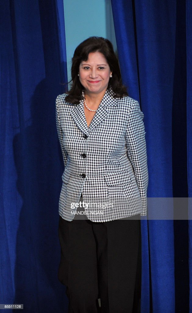 US Labor Secretary Hilda Solis makes her way to the stage during a town hall meeting by US President Barack Obama March 19 2009 at the Miguel...