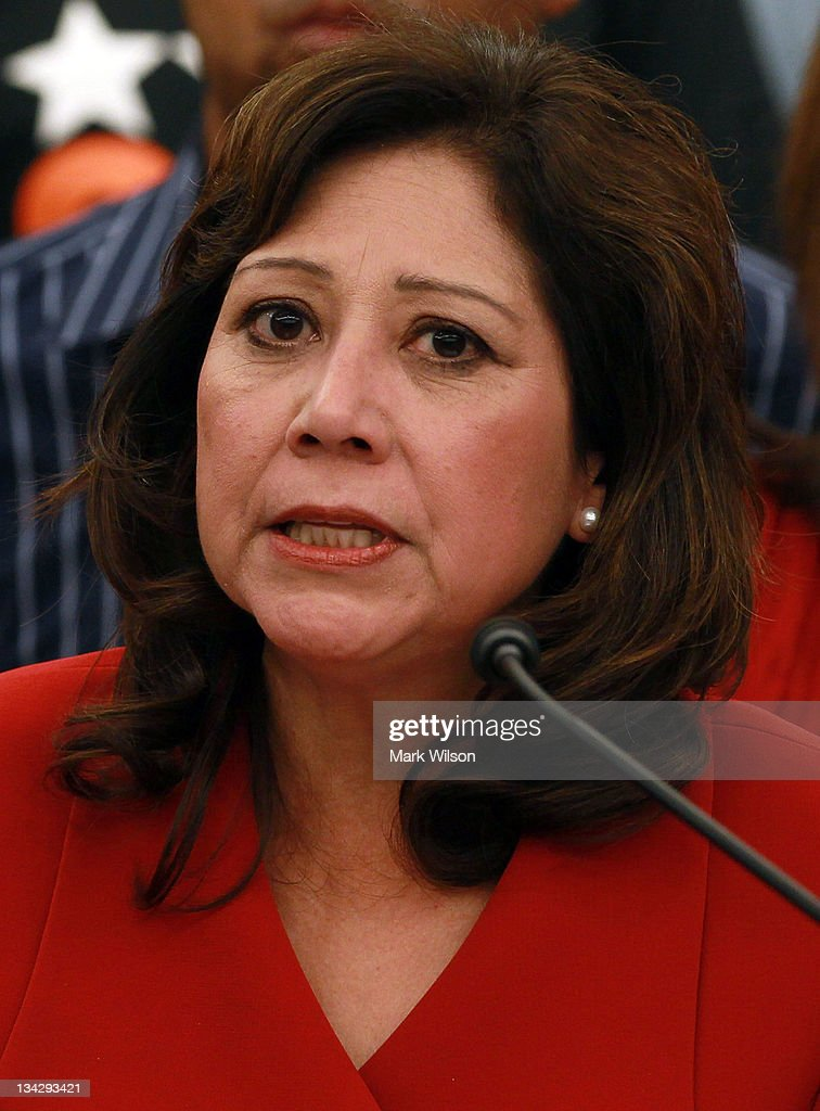 Labor Secretary Hilda Solis speaks during a news conference with unemployed workers on November 30 2011 in Washington DC Secretary Solis urged...